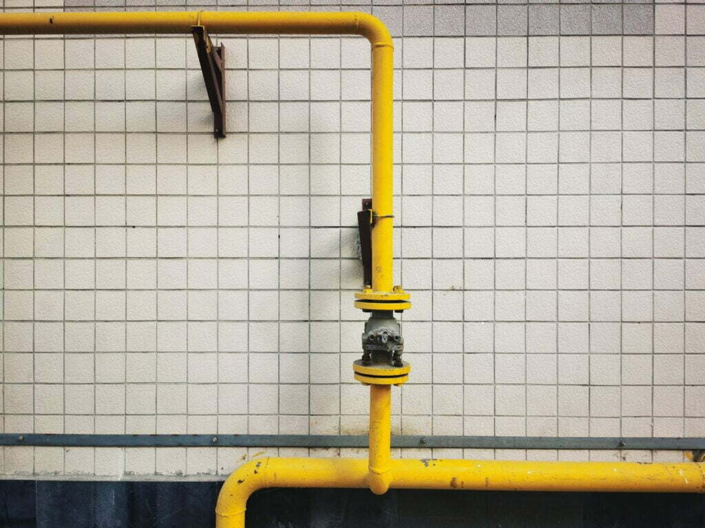yellow pipeline against tiled background representing sales pipelines