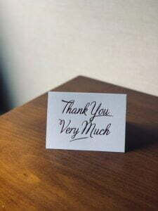 white card on wooden table saying 'thank you very much' for loyalty programmes article