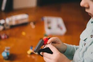 small child playing with lego to indicate building sales pipelines popcorn