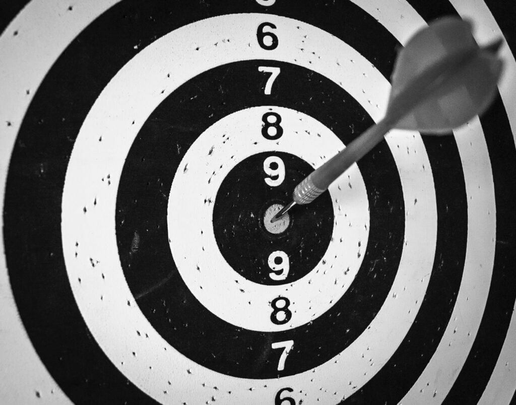 black and white target with arrow in middle