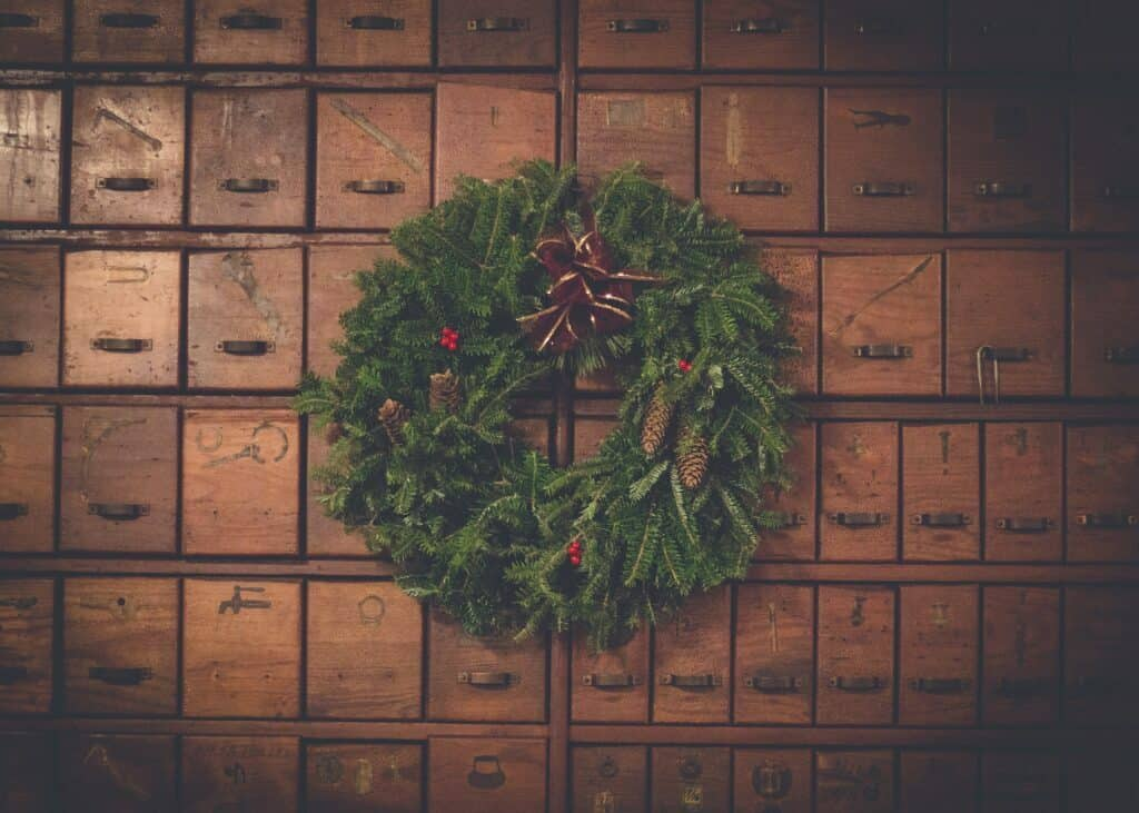 christmas wreath in front of post boxes for christmas marketing article