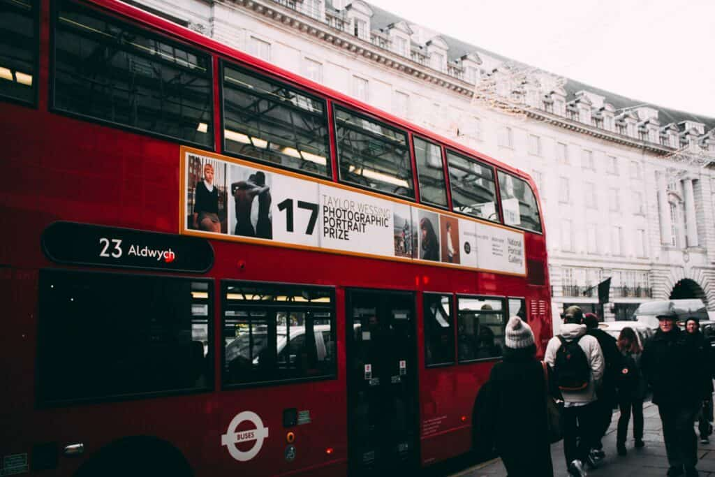 red double bus in london at christmas with advert on side of bus how to optimise your multi channel marketing for small business article