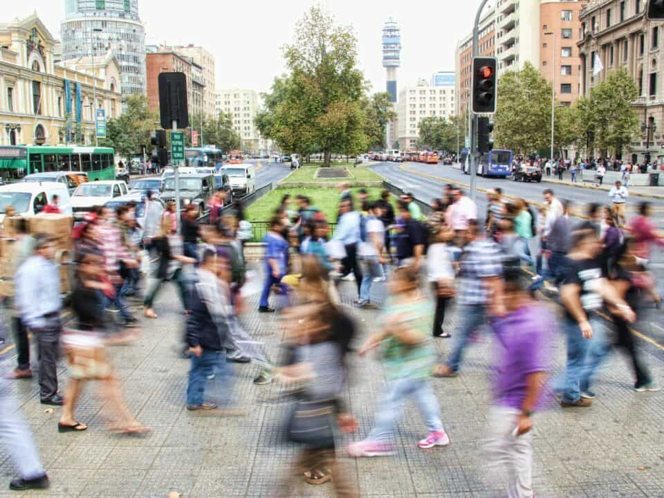 picture of crowd crossing road on busy street example of location for guerrilla marketing article