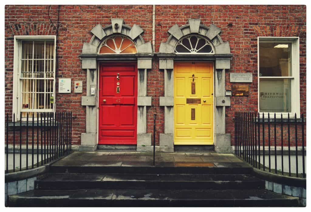 red wooden door and yellow wooden door on townhouses for how to optimise your multi channel marketing for small business article